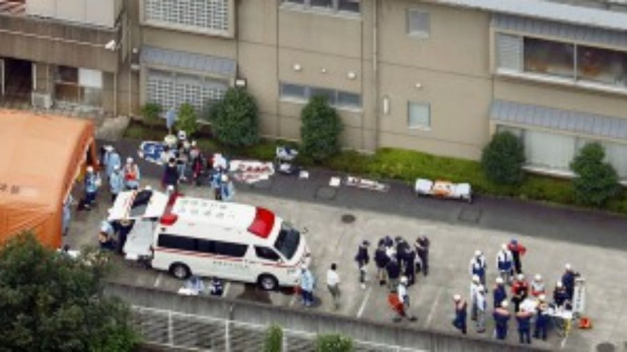 Police officers and rescue workers are seen in a facility for the disabled,
