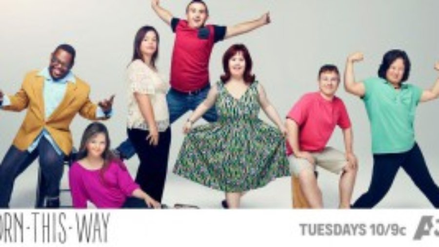 Image of cast facing camera and smiling, text on bottom says Born This Way is on A&E on Tuesdays at 10/9c