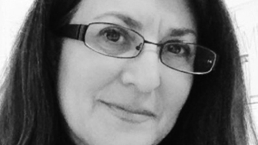 headshot of Donna Meltzer with glasses and wearing her hair loose grayscale photo