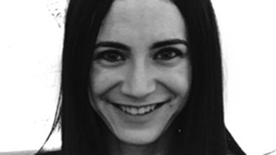 headshot of Gabrielle Einstein-Sim smiling and facing the camera wearing a tank top grayscale photo