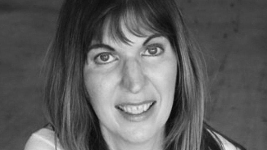 headshot of Heidi Daroff facing the camera and wearing a cardigan grayscale photo