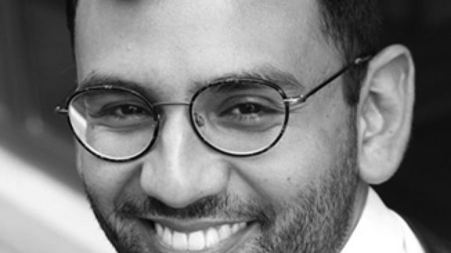 headshot of Ricky Rendon wearing glasses grayscale photo