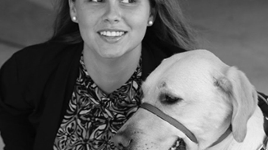 Stephanie Flynt with service dog Nala in grayscale