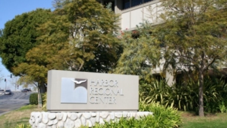 A sign outside the Harbor Regional Center with the center's logo