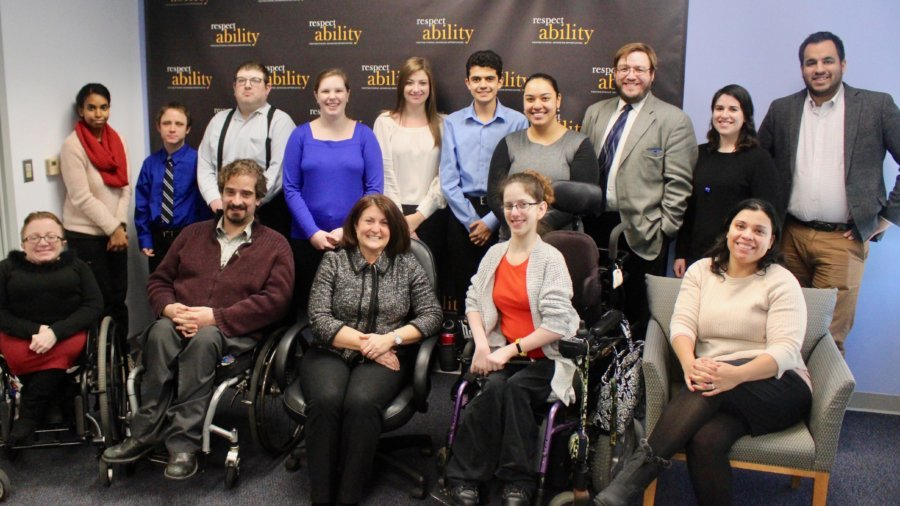 Donna Meltzer with RespectAbility staff and Fellows in front of the RespectAbility banner