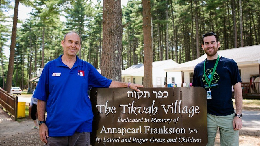 Howard Blas with a guest outside the Tikvah Village at Camp Ramah