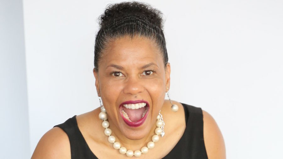 Donna Walton smiling in front of a white wall