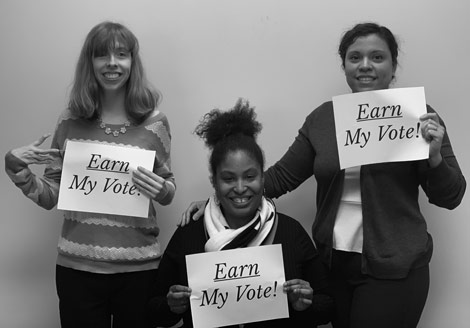 Earn My Vote - Three Women Holding Signs