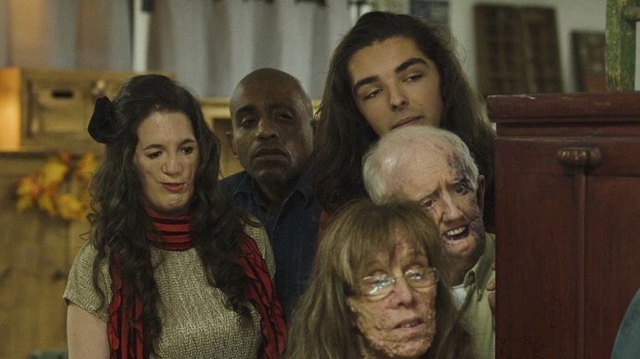 Still from the movie Happy Face with five actors looking at something off camera