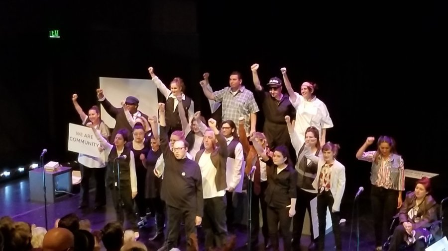 23 cast members, most who have Autism, singing on stage