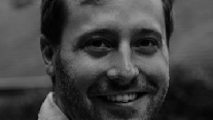 Marc Musynzski smiling headshot