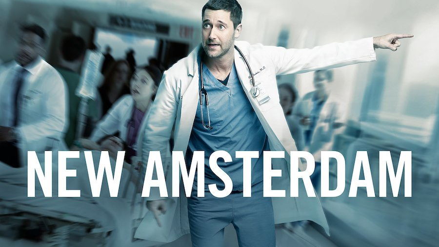 New Amsterdam key art with Ryan Eggold as Dr. Max Goodwin in scrubs walking down a hallway with other doctors in the background