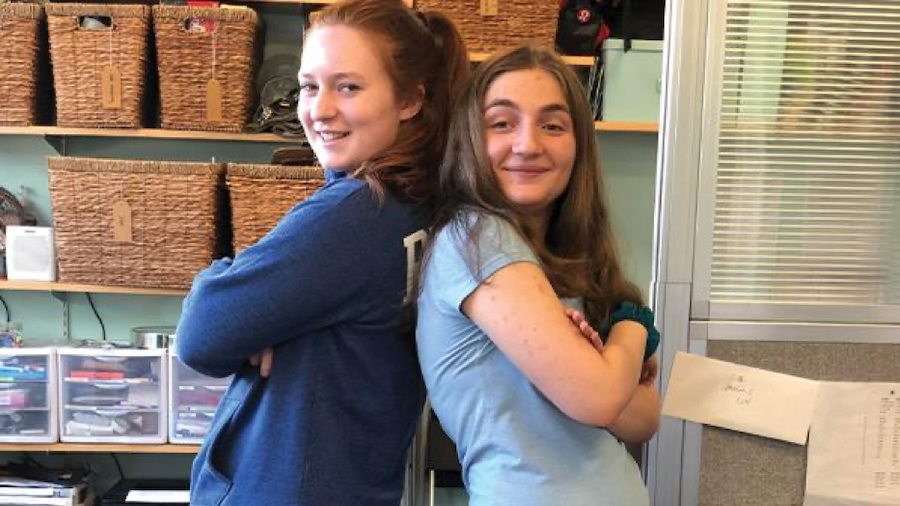 Mollie and Sydney strike a pose after finishing their work shift for the day. Their friendship is easily apparent.