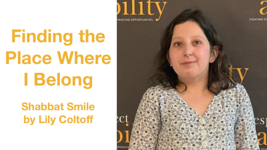 Lily Coltoff smiling in front of the RespectAbility banner. Text: Finding the Place Where I Belong Shabbat Smile by Lily Coltoff