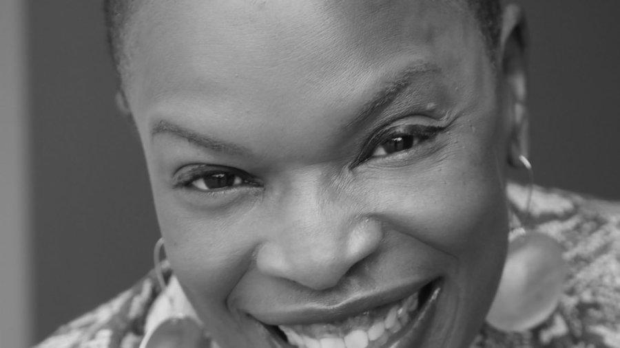 Zazel Chavah O'Garra smiling headshot