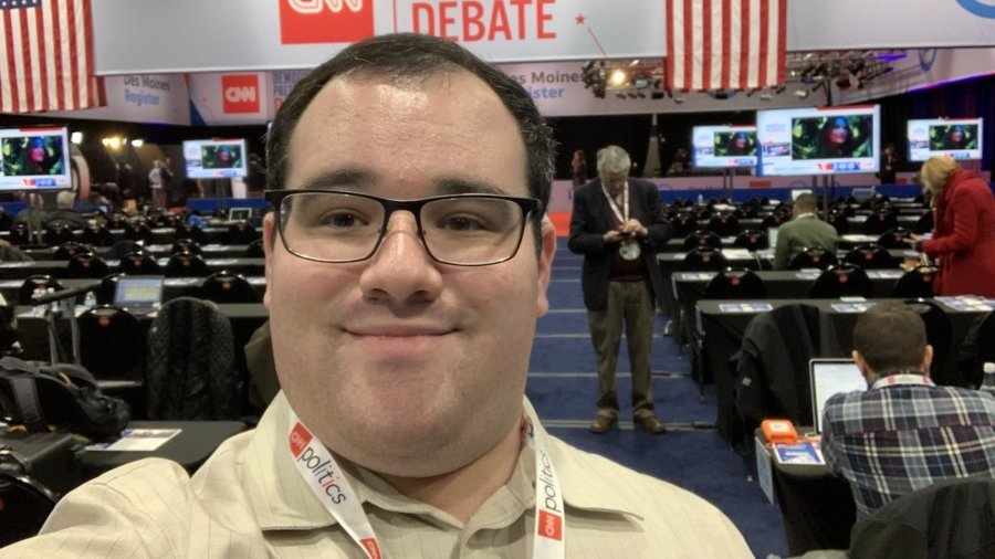 Eric Ascher smiles in the spin room at the 2020 Democratic Debate in Des Moines Iowa