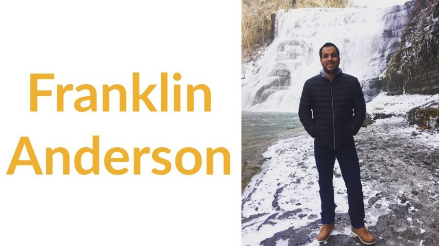 Franklin Anderson smiling, standing in front of a waterfall. Text: Franklin Anderson