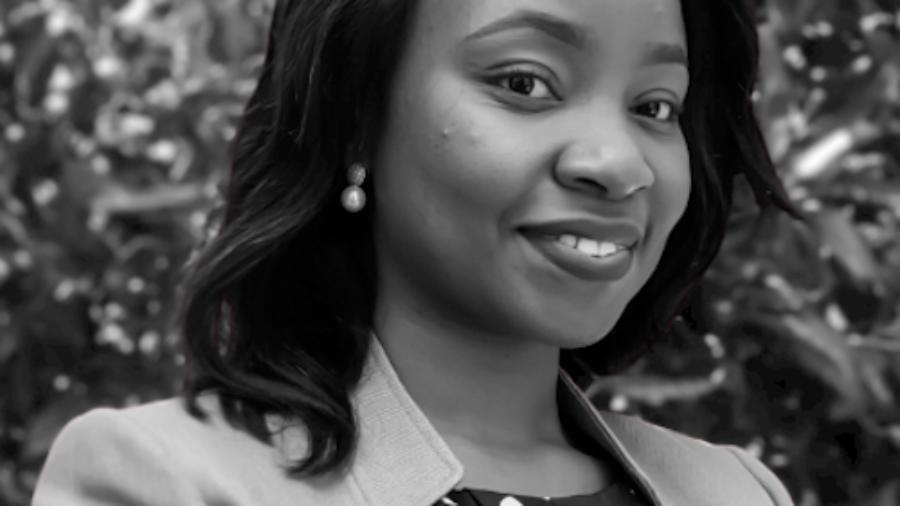 Chinyere Azike smiling black and white headshot