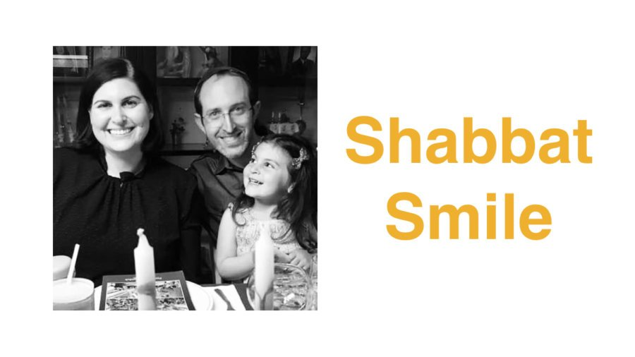 Lauren Appelbaum with her husband and daughter celebrating Passover. Text: Shabbat Smile
