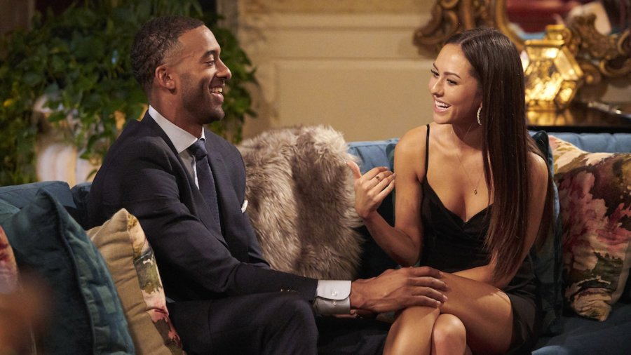 Matt James and Abigail Heringer seated on a couch talking in a scene from the Bachelor