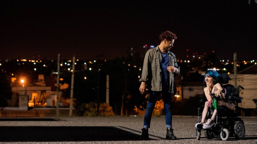 Two people talk at night, including a woman who is using a wheelchair, in a still from 4 Feet High by María Belén Poncio and Rosario Perazolo Masjoan, an official selection of the Indie Series Program at the 2021 Sundance Film Festival.