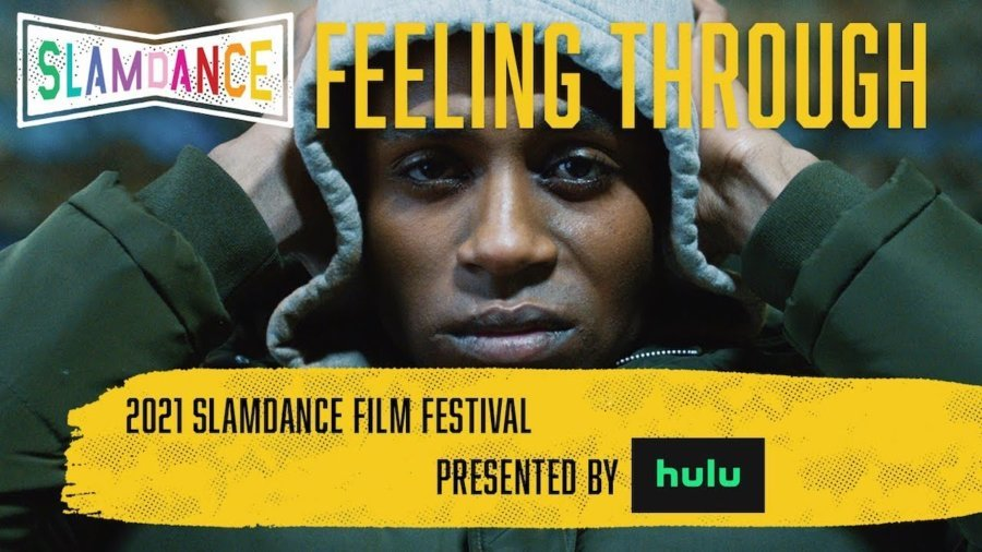 Robert Tarango with his hands on his head wearing a hat in a scene from Feeling Through. Slamdance logo. Text: