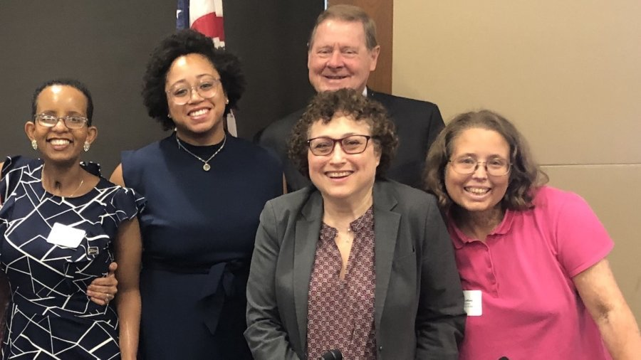 Nicole LeBlanc with other panelists at RespectAbility's 2019 Summit, smiling together.