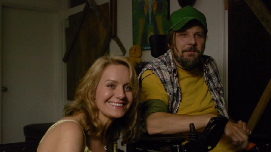 Tobias Forrest and Eileen Grubba smiling in a scene from Dead End Drive