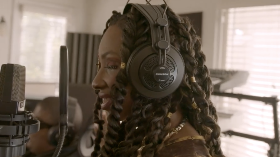 Natalie Trevonne as NayNay Too Bomb in a recording studio