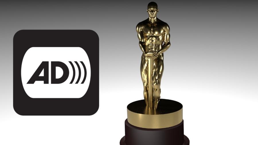 An award statue next to the icon for audio description