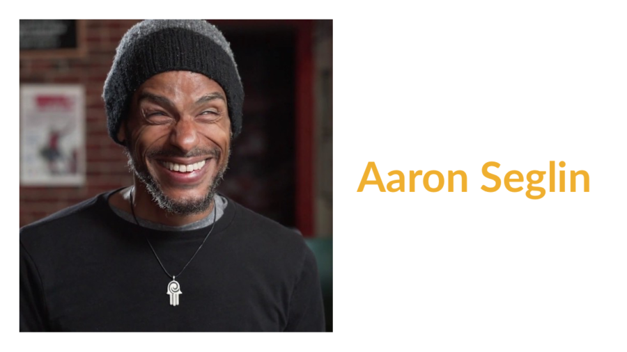 Aaron Seglin smiling headshot. Text: Aaron Seglin