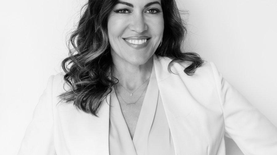 Stacie M. de Armas smiling headshot