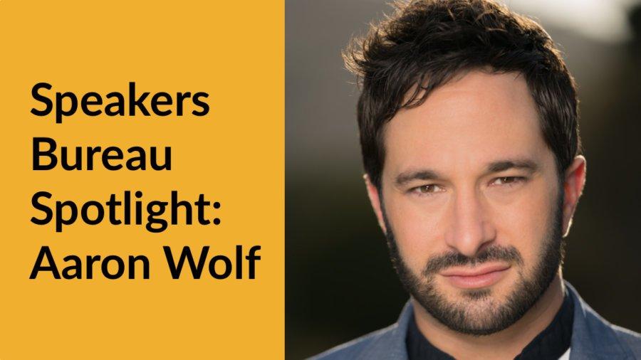 Aaron Wolf smiling headshot. Text: Speakers Bureau Spotlight: Aaron Wolf